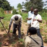 Soil scientists at AfrII host the CI President to Vital Signs data collection work in Nakasongola district